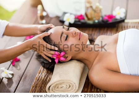Indonesian Asian woman at wellness spa massage Stock photo © Kzenon