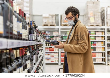 Man selecting wine in liquor store Stock photo © Kzenon