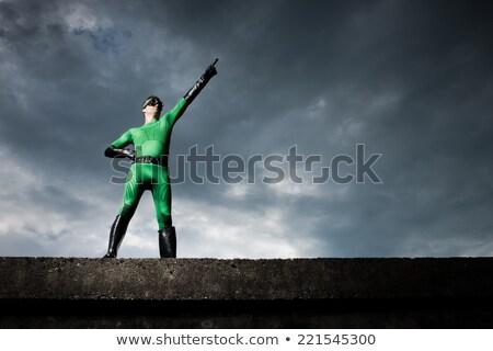 英雄 指向 戲劇性 綠色 多雲 天空 商業照片 © stokkete