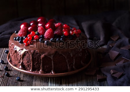 Stock photo: Slice of delicious chocolate cake with red currants