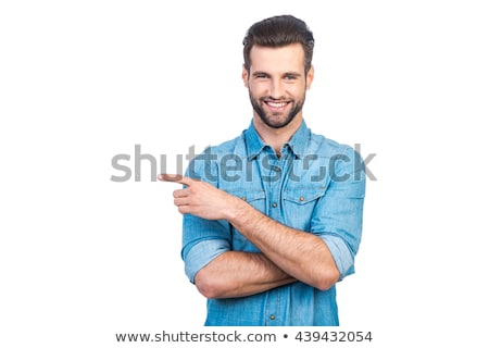 smiling man pointing away over white background stock photo © deandrobot