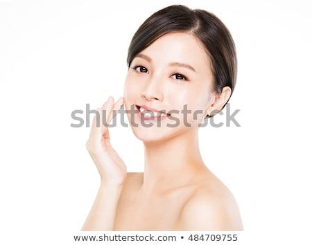 closeup portrait of a young beautiful asian woman stock photo © deandrobot