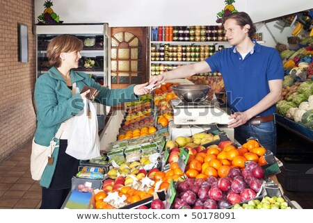 Greengrocer  serving a customer Stock photo © photography33