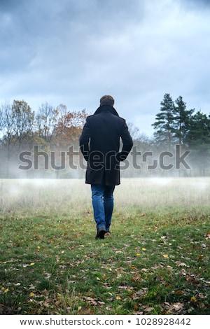 moço · preto · casaco · profissional · câmera - foto stock © acidgrey
