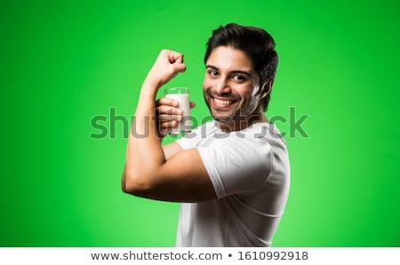 Heureux musculaire homme potable protéines boire Photo stock © wavebreak_media
