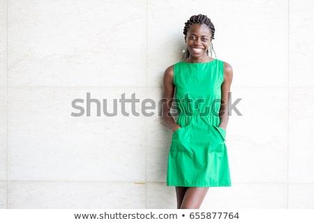 young woman wearing green dress stock photo © elnur