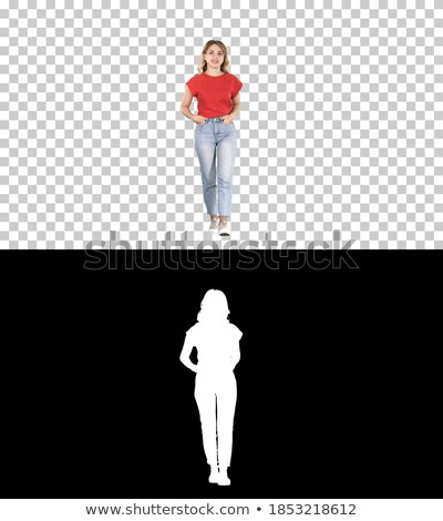 blonde girl walking with her hands in pockets stock photo © feedough