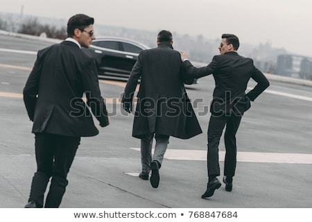 Two bodyguards protect businessman Stock photo © Paha_L