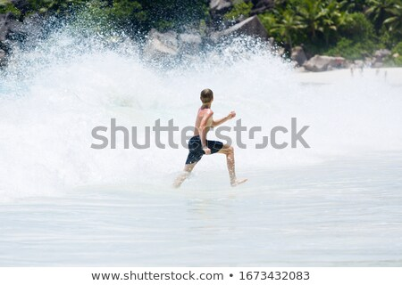teenager escaping from sea wave Stock photo © Paha_L