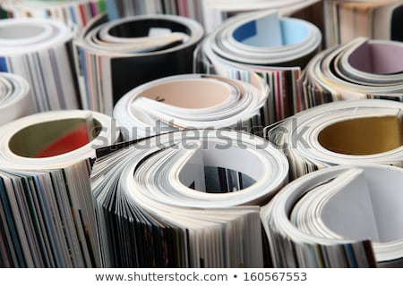 Stock photo: curled magazined on stack
