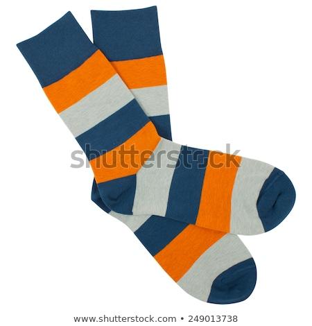 Orange rayé chaussettes isolé blanche bébé Photo stock © shutswis