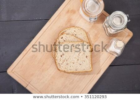 Glutensiz ekmek çiçek siyah ahşap arka plan Stok fotoğraf © gigra