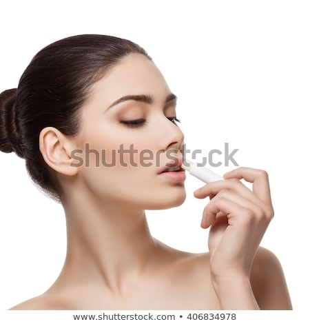Beautiful girl applying chapstick Stock photo © svetography