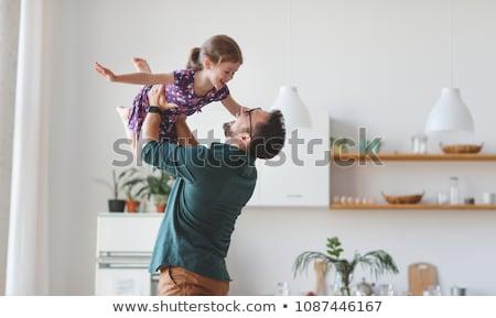 Cheerful child hugging father Stock photo © ozgur