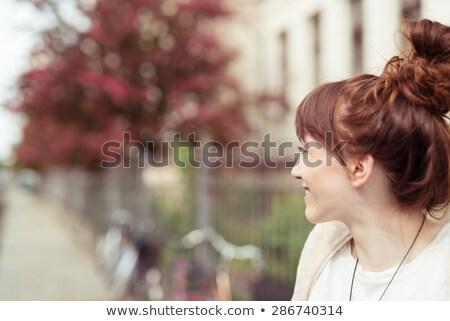 Csinos lezser barna hajú másfelé néz fehér arc Stock fotó © wavebreak_media