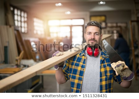Smiling worker with saw. Stock photo © RAStudio