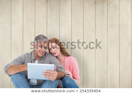 composite image of woman using tablet pc stock photo © wavebreak_media