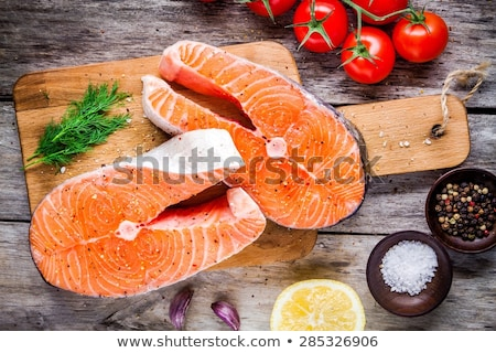raw salmon fish steak on wooden rustic background Stock photo © yelenayemchuk