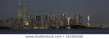 Gêmeo torres pôr do sol noite nuvens céu Foto stock © mayboro1964