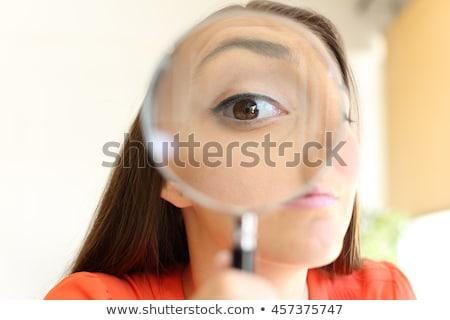 Zdjęcia stock: Enlarged Eye Of Tax Inspector Looking Through Magnifying Glass