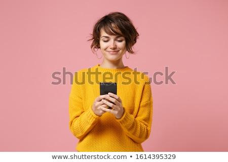 mosolyog · fiatal · lány · mobiltelefon · ül · pad · kint - stock fotó © deandrobot