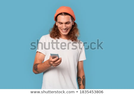 Handsome happy smiling adolescent man Stock photo © phakimata