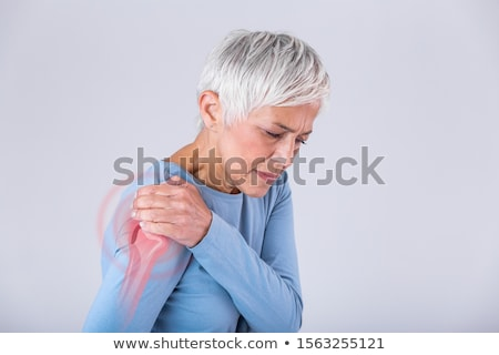 muscular · homem · dor · no · ombro · cinza · corpo · saúde - foto stock © kalozzolak