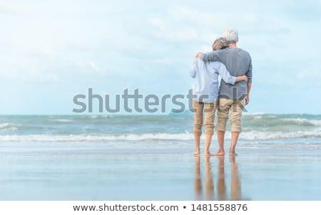 arkadan · görünüm · mutlu · çift · yürüyüş · plaj - stok fotoğraf © deandrobot