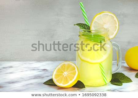 Glass of lemon-flavored drink Stock photo © Digifoodstock