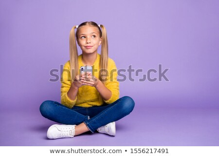 Female sitting with legs crossed and thinking Stock photo © Decorwithme