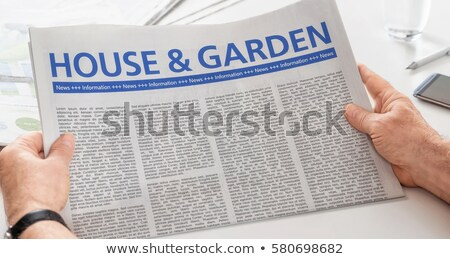 Man reading newspaper with the headline House and Garden Stock photo © Zerbor