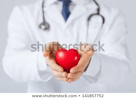 Médico cardiologista coração uniforme mão Foto stock © RAStudio