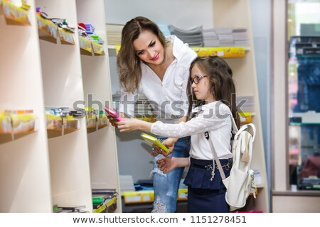 Family with two kids choosing school satchel in store Stock photo © Kzenon