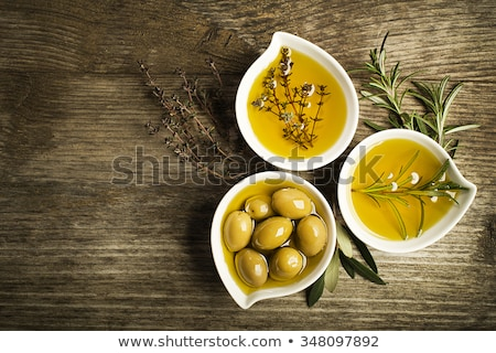 italian food ingredients, rosemary, olives, olive oil on wooden background Stock photo © yelenayemchuk