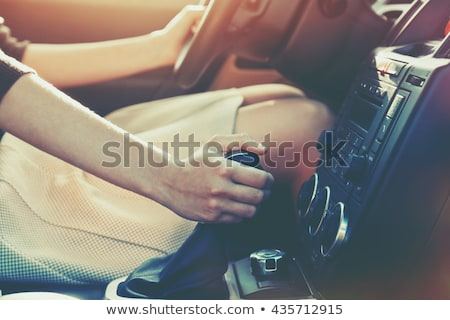 Woman shifting gears on gearbox and driving car Stock photo © vlad_star