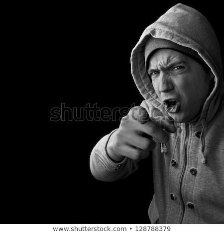Ameaçador homem pontos dedo acima ver Foto stock © filipw