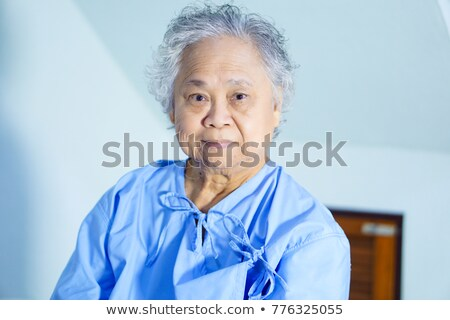 Happy bald asian lady point to head stock photo © palangsi