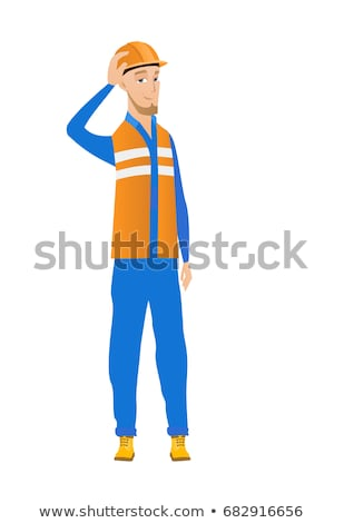 Young caucasian builder scratching head. Stock photo © RAStudio