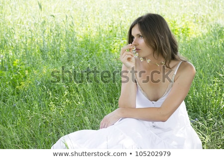 Young girl with daisy chain necklace Stock photo © IS2