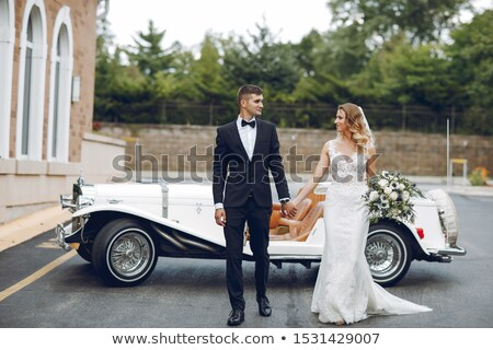 Portrait of bride and groom in car Stock photo © IS2