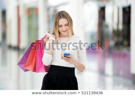 Tini bevásárlótáskák sms üzenetküldés nő telefon jókedv Stock fotó © IS2