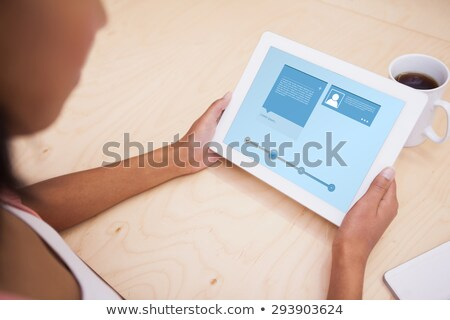 creative african woman with tablet pc at office stock photo © dolgachov