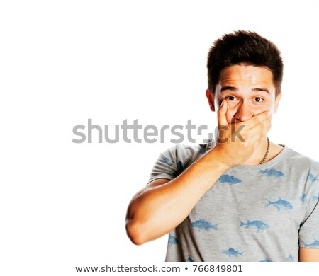 young pretty man holding hand on mouth like silence, mute isolated Stock photo © iordani