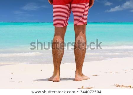 Yalınayak adam ayakta plaj kumu üst görmek Stok fotoğraf © stevanovicigor