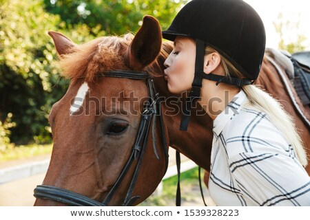 Girl kissing horse in yard Stock photo © IS2
