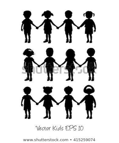 Stock photo: A boy and girl holding hands
