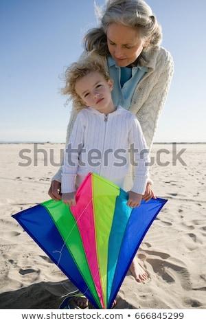 Avó neta jogar pipa praia criança Foto stock © IS2