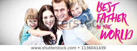 Happy parent giving piggyback to their childs against close up of pink best father in the world text Stock photo © wavebreak_media