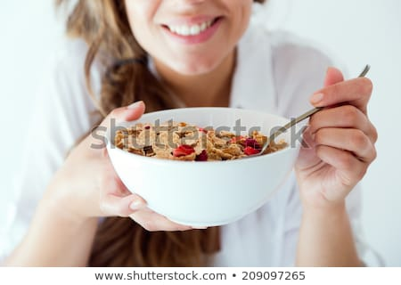 Manger céréales femme sexy séance lit céréales Photo stock © stryjek