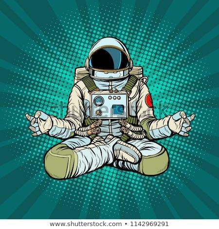 yoga astronaut lotus pose meditation and spiritual practice stock photo © studiostoks